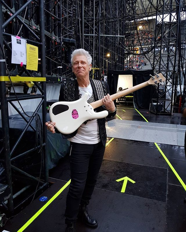 Adam With Pink Adam Sticker On The Back Of His Bass. Photo from U2's Instagram.
