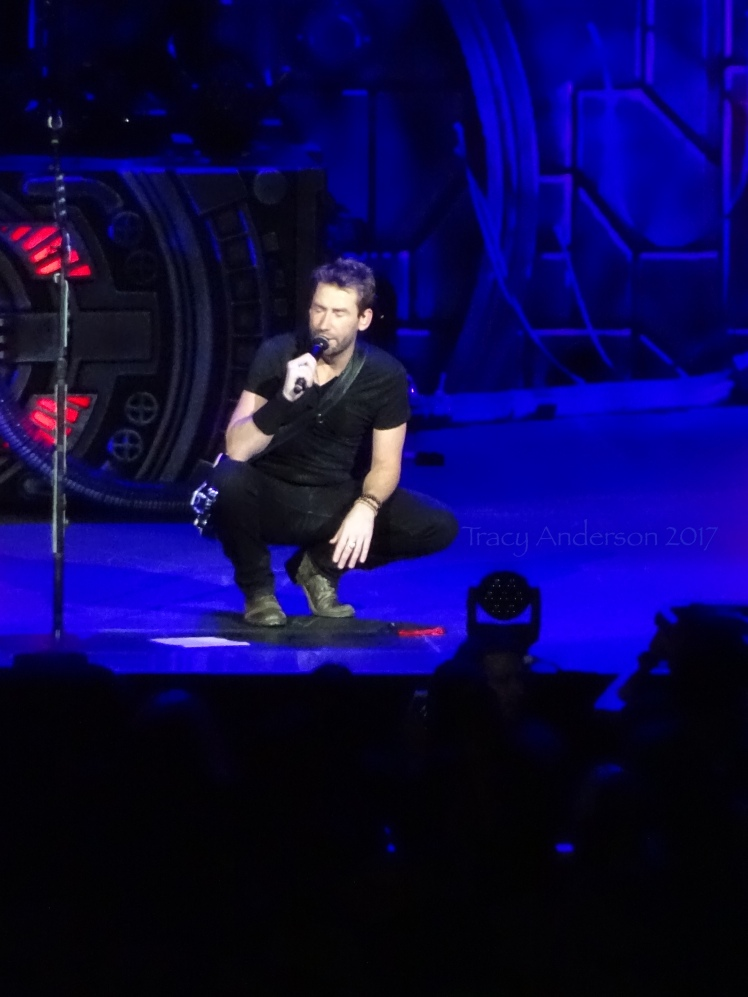 Chad Kroeger of Nickelback kneeling Rogers Place Edmonton Sept 28 2017